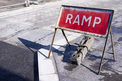 Ramp on road sign new construction street path highways warning for cars, trucks vehicles people pedestrians and drivers royalty free stock image