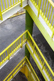Ramp with several floors. Yellow railing. Royalty Free Stock Images