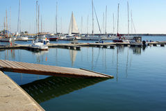 Ramp in touristic port. Wooden ramp in touristic port with luxury boats Royalty Free Stock Photo