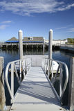 Ramp by water. Long metal ramp leading to a dock by a harbor in Stonington Connecticut Royalty Free Stock Images