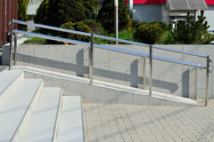 Ramp. For wheelchair entry with metal handrails Royalty Free Stock Photography