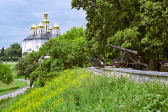 Rampart with cannons and Church Stock Image
