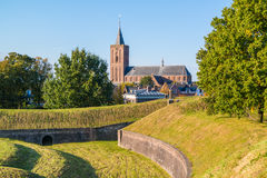 Rampart and church of Naarden, Netherlands. Big Church and rampart with bastion Promers in old fortified town of Naarden, North Holland, Netherlands Stock Photos
