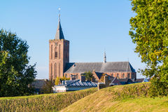 Rampart and church of Naarden, Netherlands. Big Church and rampart in old fortified town of Naarden, North Holland, Netherlands Royalty Free Stock Image