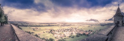 From the Ramparts. The modern town of Gruyeres sits below the castle ramparts stock image
