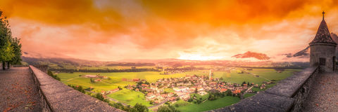 From the Ramparts. The modern town of Gruyeres sits below the castle ramparts stock photo