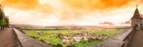 From the Ramparts. The modern town of Gruyeres sits below the castle ramparts stock photos