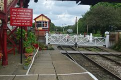 Ramsbottom Level Crossing on the East Lancs Railway. Lancashire. The level crossing remains at the north end of the platforms, and retains its wooden gates stock image