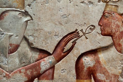 Ramses II and falcon-head god Horus. Ancient egyptian relief depicting pharaoh Ramses II and falcon-head god Horus. Horus points the ankh (sign of life) to royalty free stock image
