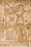Ramses and Ptah Ancient Egypt Hieroglyph. An ancient Egyptian hieroglyphic carving of the Pharoah Ramses II with the creator god Ptah.  Stone wall at the Temple Stock Photo
