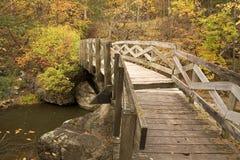 Ramsey Creek Scenic Bridge. A wooden walk bridge crosses Ramsey Creek in Minnesota Stock Images