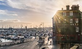 Ramsgate Harbour, Kent, UK. Ramsgate, UK - Jan 22 2018.  The late afternoon sun behind a large public house in the impressive and historic Royal Harbour of Royalty Free Stock Photos