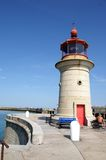 Ramsgate Harbor Light House. The Ramsgate light house at the end of the harbor wall, at the entrance/exit. Picture good to show Ramsgate harbor features Royalty Free Stock Photo
