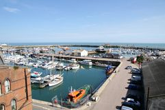 Ramsgate harbor. Showing moored boats and yachts and life boats. Picture is ideal to show location features Stock Photos