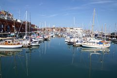 Ramsgate Harbor. Showing moored up boats and yachts, with the town in the back ground. Picture is ideal to show location features and sights Stock Image