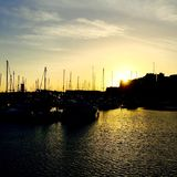 Ramsgate Harbour Sunset. The sun setting over the boats at the beautiful Ramsgate Royal Harbour Stock Photos