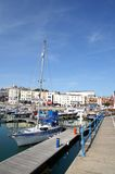 Ramsgate Harbor. In Ramsgate harbor with the town centre in the back ground and a yacht in the fore  ground. Picture is good to show location sights and features Royalty Free Stock Image