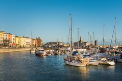 Ramsgate, Kent, UK marina. RAMSGATE, ENGLAND - NOV 23 2017.  Buildings  and boats in and around the marina in the winter evening sunshine. The town has one of Stock Photos