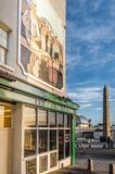 Ramsgate`s Obelisk and on of the fish and chip restaurants on th. Ramsgate, UK - Jan 22 2018.  The impressive mural above Peter`s Fish Factory on the harbour Stock Photos