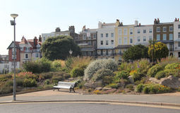 Ramsgate Side Walk. This photo shows a pretty side walk in Ramsgate and a bench for the weary soul Royalty Free Stock Images