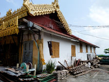 Ramshackle Pagoda House with Bomb Bell in Burma Stock Photos