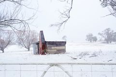 Ramshackle rustic shack in snowy rural scene royalty free stock images