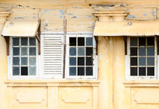 Ramshackle windows with breaked glass Royalty Free Stock Photography