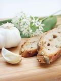 Ramson, garlic and bread. Fresh ramson, garlic and bread on a wooden cutting board Stock Photos