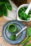 Ramson pesto and ingredients for cooking it on a wooden table. Rustic style. royalty free stock image