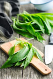 Ramson or wild garlic leaves. On cutting board Stock Photo