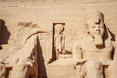 Ramsses the second or Ramsses the Great and Horus statues carved in rock at Abu Simbel Temple. Egyptian civilization history well preserved at one of the most stock photos