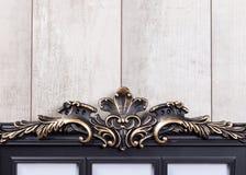 Ramtappning på den wood väggen Royaltyfri Bild