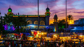 Ramzan festivities in Hyderabad. Ramzan festivities in the old city of Hyderabad, India. People breaking their fast at dusk and praying in the holy Mecca Masjid Royalty Free Stock Photography