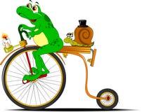Rana y caracol en una bicicleta Imagenes de archivo