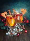 Сranberry hot punch in glass. Hot drink, cranberry punch with orange, cinnamon and anise. Winter and Christmas festive decor Royalty Free Stock Photos