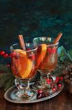 Сranberry punch in glass. Hot drink, cranberry punch with orange, cinnamon and anise. Winter and Christmas festive decor Royalty Free Stock Photography