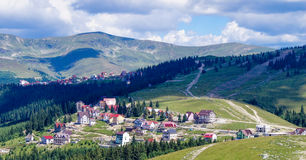 Ranca, Transalpina. Rânca is a recently developed Romanian resort, located at 1,600 m elevation, at the foothill of Păpuşa Peak in the Parâng Mountains Stock Photography