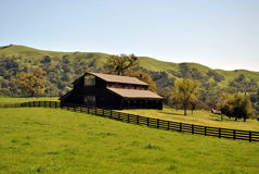 Ranch Barn. Old ranch barn in the grassy hills Stock Images