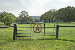 Ranch gate with pasture and trees in the Texas Hill Country Stock Image