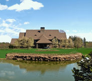 Ranch house. And pond in american midwest Royalty Free Stock Photos