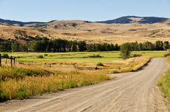 Ranch Land Along a Gravel Road Royalty Free Stock Images