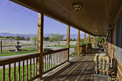 Ranch porch overlooking horse stables Stock Photo