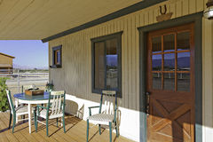 Ranch porch overlooking horse stables Stock Photography