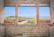Ranch road through mountain valley  - mwindow view Royalty Free Stock Images
