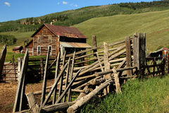 Ranch Rural. Rural scene of old abandoned ranch house and livestock pens in the mountains in summer stock images