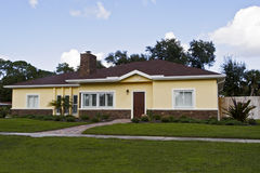 Ranch style home. Neat yellow single level home Stock Photos