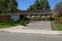 Ranch Style Home With Great Roses. Exterior shot of a ranch style home with reat blooming roses Royalty Free Stock Photo