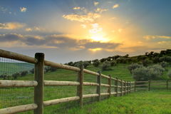 Ranch sunset. Sunset over a wooden fence on a ranch near Craig, CO royalty free stock photography
