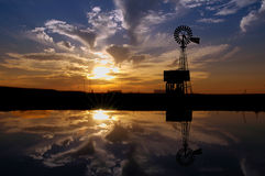 Ranch Windmill at Sunset royalty free stock photos