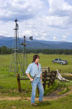 Rancheiro no oeste, funcionamento do gado do homem Imagem de Stock